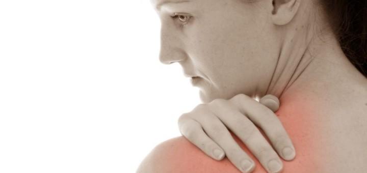 woman touching shoulder