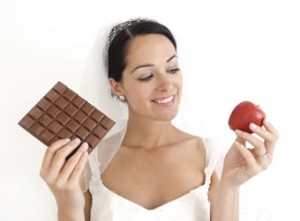 bride holding chocolate and apple