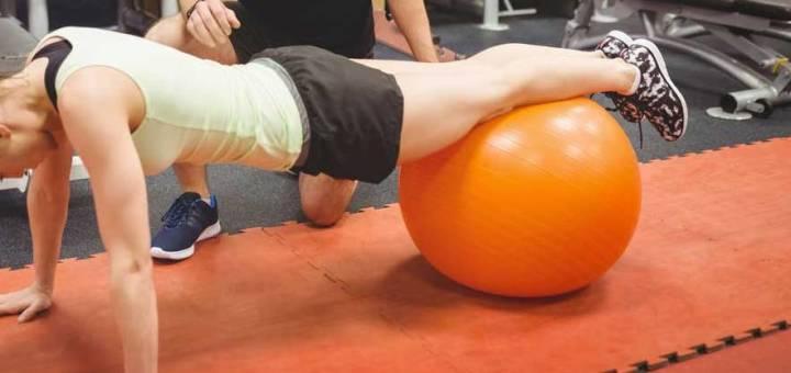 woman using yoga ball