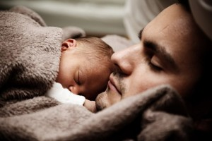 baby and man sleeping