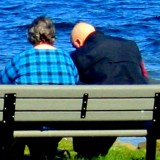 2 men sitting on bench