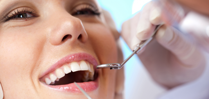 smiling woman with dentist